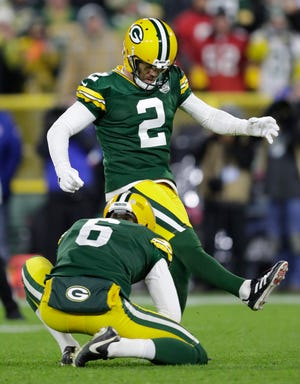 Green Bay Packers kicker Mason Crosby (2) kicks the game-winning field goal against the San Francisco 49ers during their football game Monday, Oct. 15, 2018, at Lambeau Field in Green Bay, Wis.