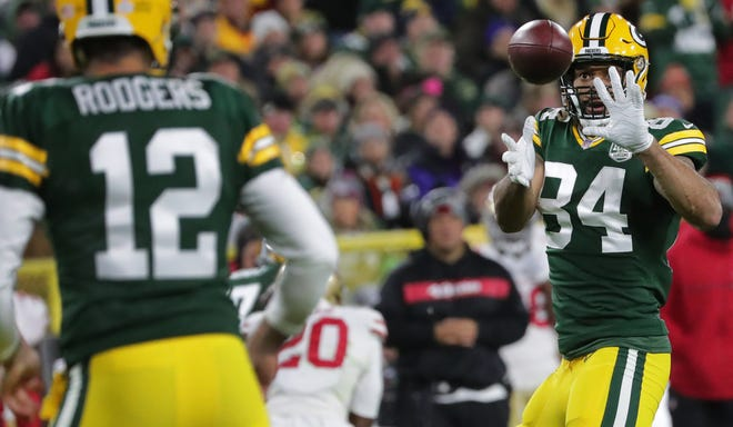 Green Bay Packers quarterback Aaron Rodgers (12) makes a first down throw to tight end Lance Kendricks (84) during the first quarter of their game against the San Francisco 49ers Monday, October 15, 2018 at Lambeau Field in Green Bay, Wis.MARK HOFFMAN/ MHOFFMAN@JOURNALSENTINEL.COM