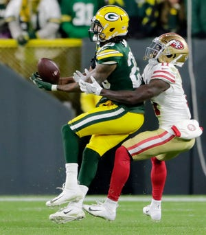 Green Bay Packers cornerback Kevin King (20) intercepts a pass intended for San Francisco 49ers wide receiver Marquise Goodwin (11) in the fourth quarter at Lambeau Field on Monday, October 15, 2018 in Green Bay, Wis.