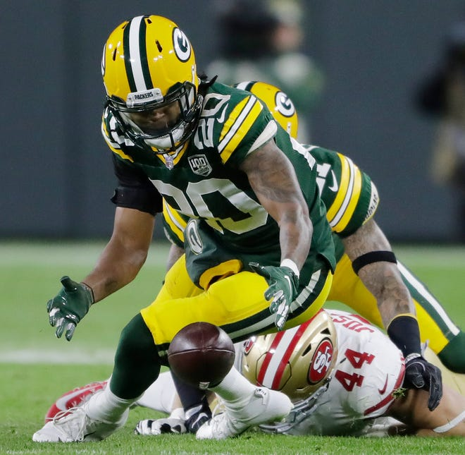 Green Bay Packers cornerback Kevin King (20) recovers a fumble by San Francisco 49ers running back Kyle Juszczyk (44) in the second quarter at Lambeau Field on Monday, October 15, 2018 in Green Bay, Wis.