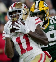San Francisco 49ers wide receiver Marquise Goodwin (11) reels in a 67-yard touchdown catch while being covered by Green Bay Packers strong safety Kentrell Brice (29) during the first quarter of their game Monday, October 15, 2018 at Lambeau Field in Green Bay, Wis.