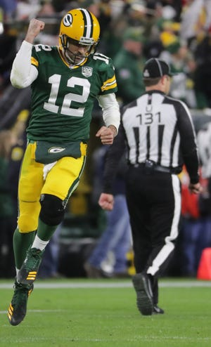 Green Bay Packers quarterback Aaron Rodgers (12) reacts  after throwing a touchdown pass to wide receiver Davante Adams during the fourth quarter of their game Monday, October 15, 2018 at Lambeau Field in Green Bay, Wis. The Green Bay Packer beat the San Francisco 49ers 33-30.