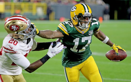 Green Bay Packers wide receiver Davante Adams stiff-arms cornerback Jimmie Ward of the San Francisco 49ers in an October game at Lambeau Field.