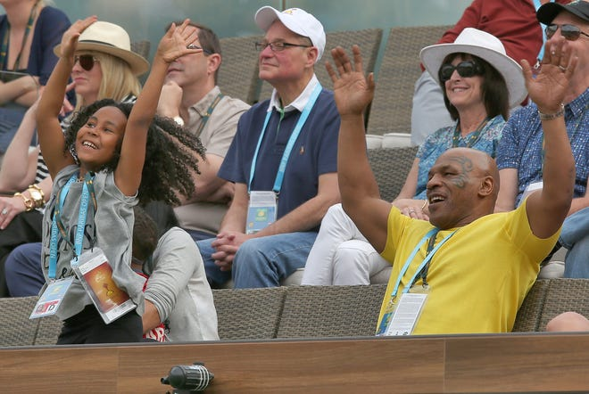 Mike Tyson and daughter Milan enjoy being on the fan-cam during Serena Williams' victory over Yulia Putintseva at the BNP Paribas Open in Indian Wells.
