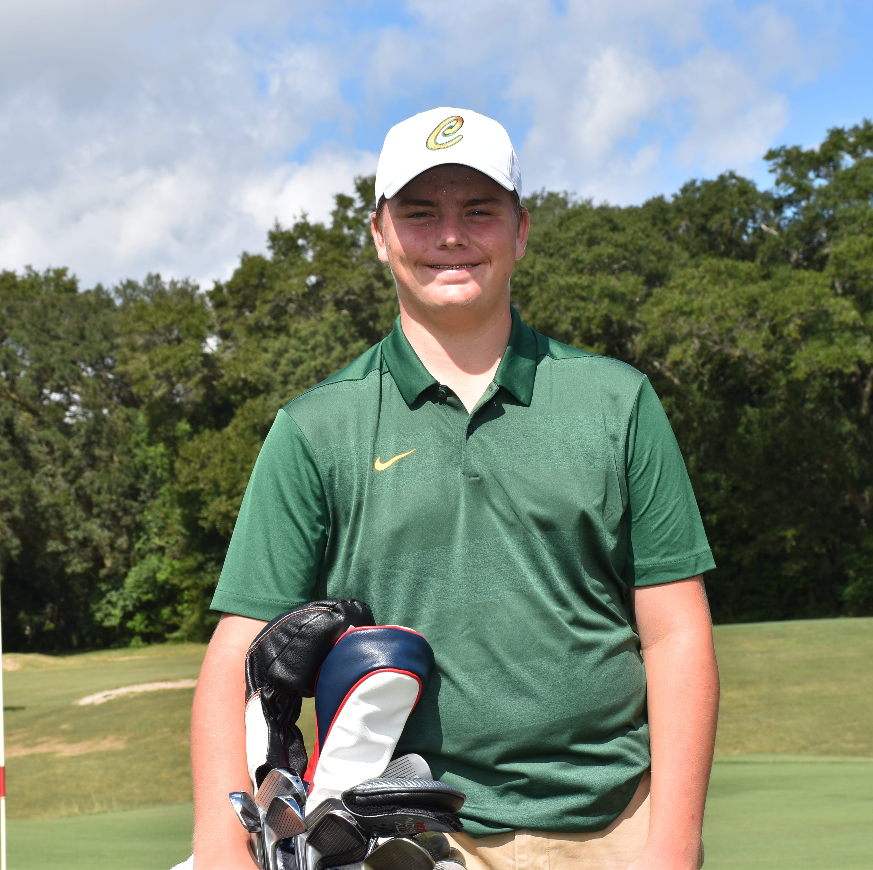 Pensacola Catholic freshman Justin Burroughs in front of the par-4, 313-yard No. 9 hole at Osceola Golf Course where he produced a hole-in-one Tuesday with his tee shot to win the District 1-1A boys golf championship.