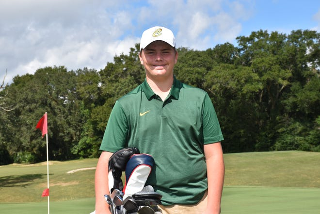 Pensacola Catholic's Justin Burroughs, shown after winning the District 1-1A golf tournament with a hole-in-one on a par-4 hole, finished tied for sixth in the state at the Class 1A golf championship Wednesday.
