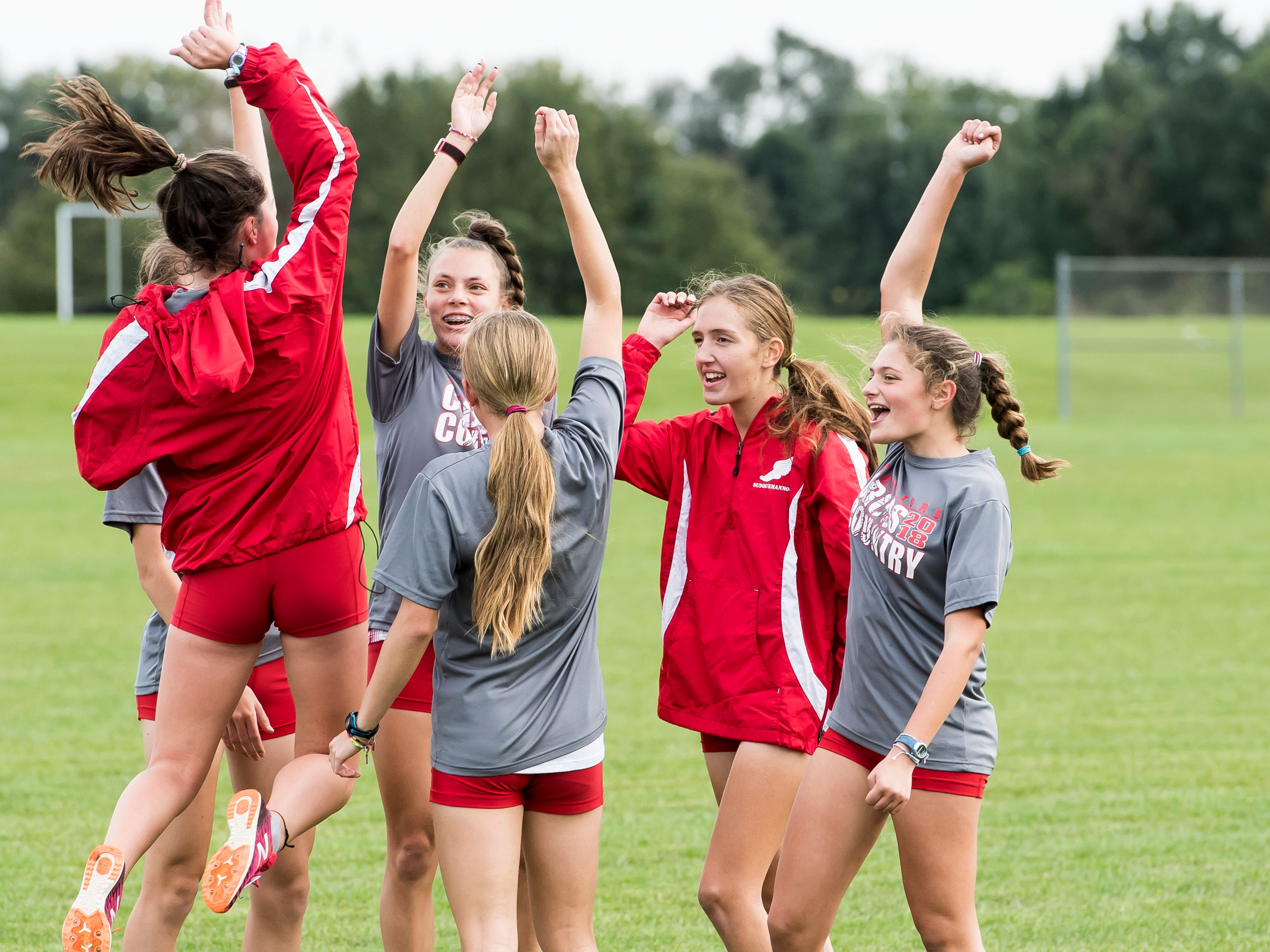 The Susquehannock Warriors girls' cross country team huddle up prior the YAIAA cross country championships at Gettysburg Area High School on Tuesday, October 16, 2018.