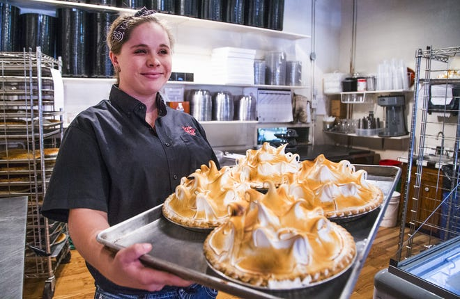 Rock Springs Cafe in Black Canyon City will celebrate its 100-year anniversary with a music festival. The cafe is famous around the country for its delicious pies. Employee Lacey McElroy prepares to put freshly-baked lemon meringue pies on the cooling rack.