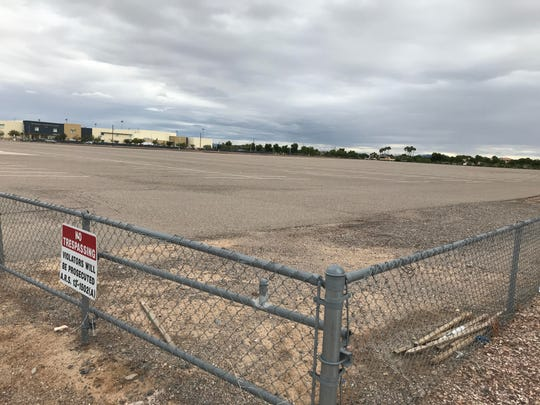 Apartments may come to the city-owned brown lot near Westgate that has been used for Arizona Cardinals games.