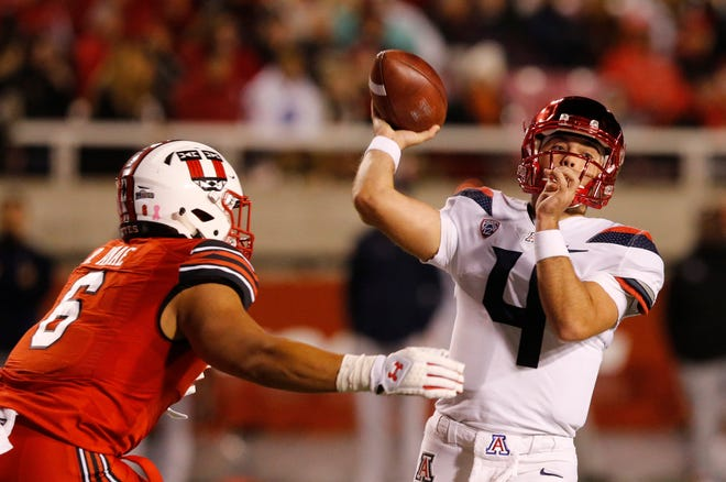 Arizona quarterback Rhett Rodriguez (4) throws a pass as Utah defensive end Bradlee Anae (6) closes in during the second half of an NCAA college football game Friday, Oct. 12, 2018, in Salt Lake City.