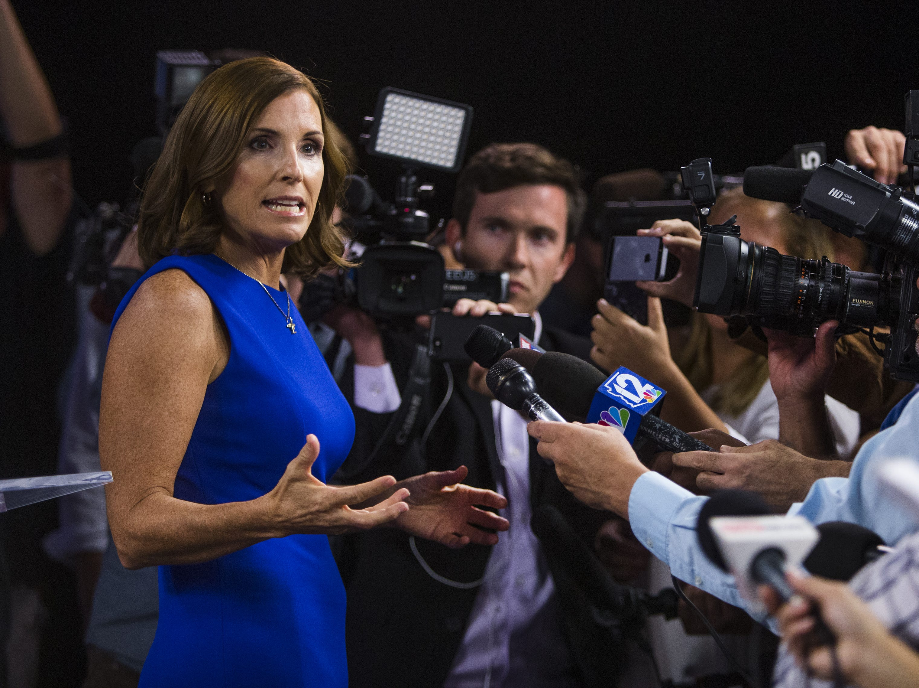 Rep. Martha McSally takes questions from the press after debating Rep. Kyrsten Sinema in the Arizona PBS studios at the Walter Cronkite School of Journalism and Mass Communication at Arizona State University in Phoenix on Oct. 15, 2018.