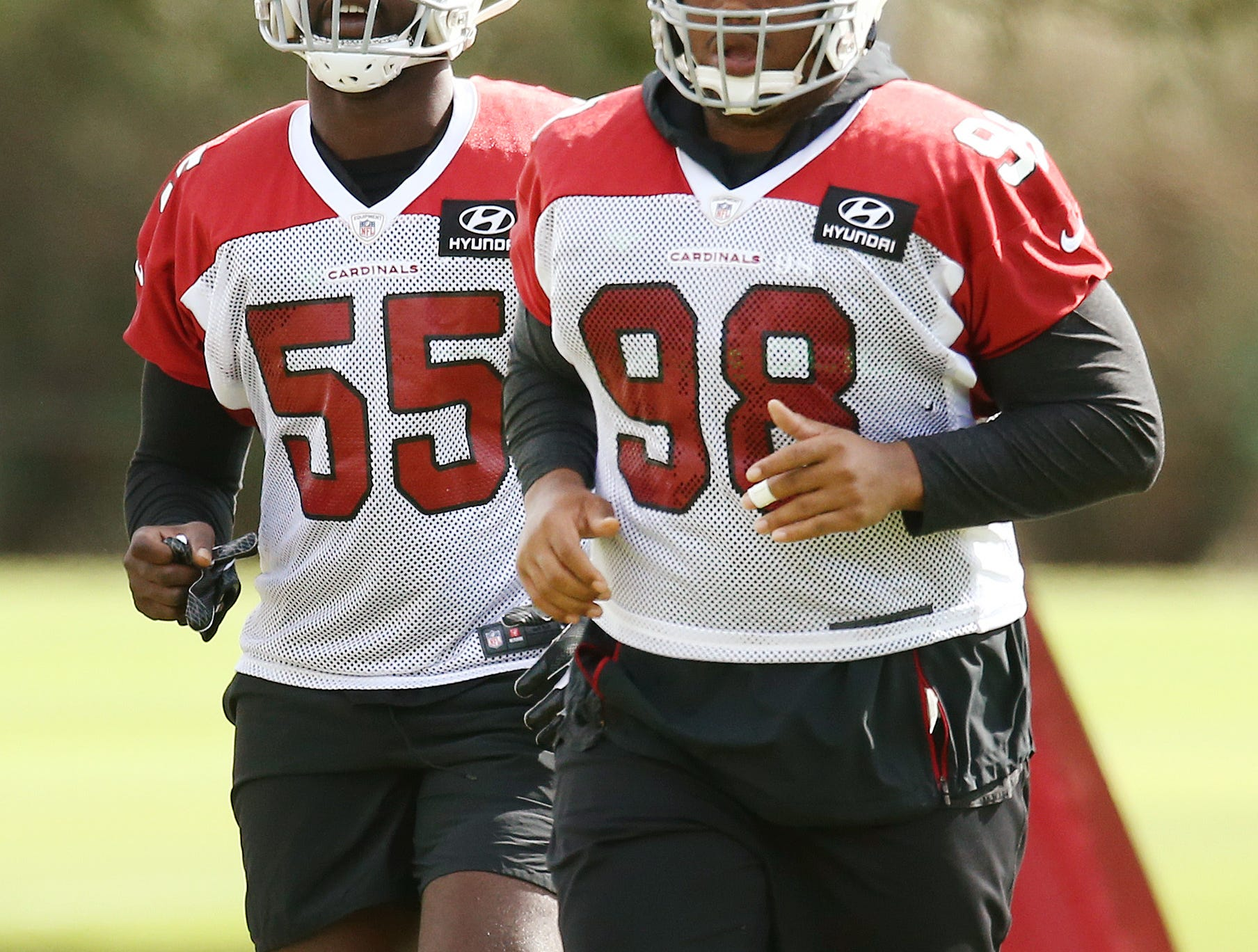 Arizona defensive tackle Corey Peterts (98) and defensive end Chandler Jones (55) during practice on Oct. 16, 2018 at the Cardinals Training Facility in Tempe, Ariz.