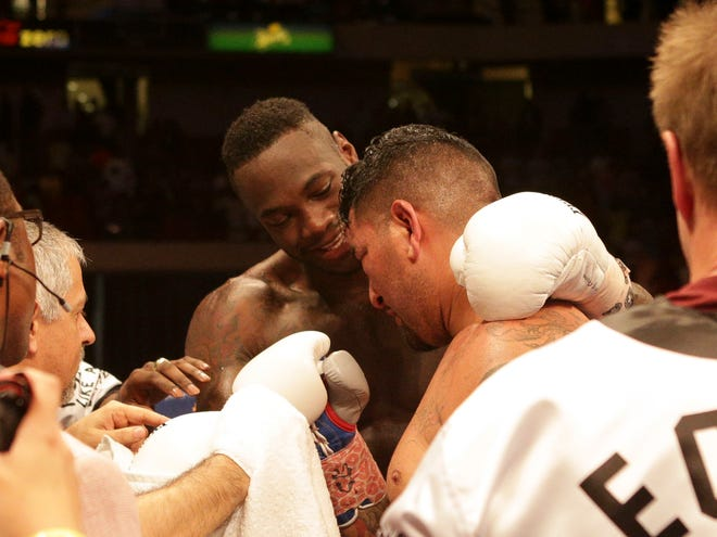 Jul 16, 2016; Birmingham, AL, USA; Deontay Wilder talks with opponent Chris Arreola after their title bout at Premier Boxing Championships fight at Legacy Arena. Mandatory Credit: Marvin Gentry-USA TODAY Sports