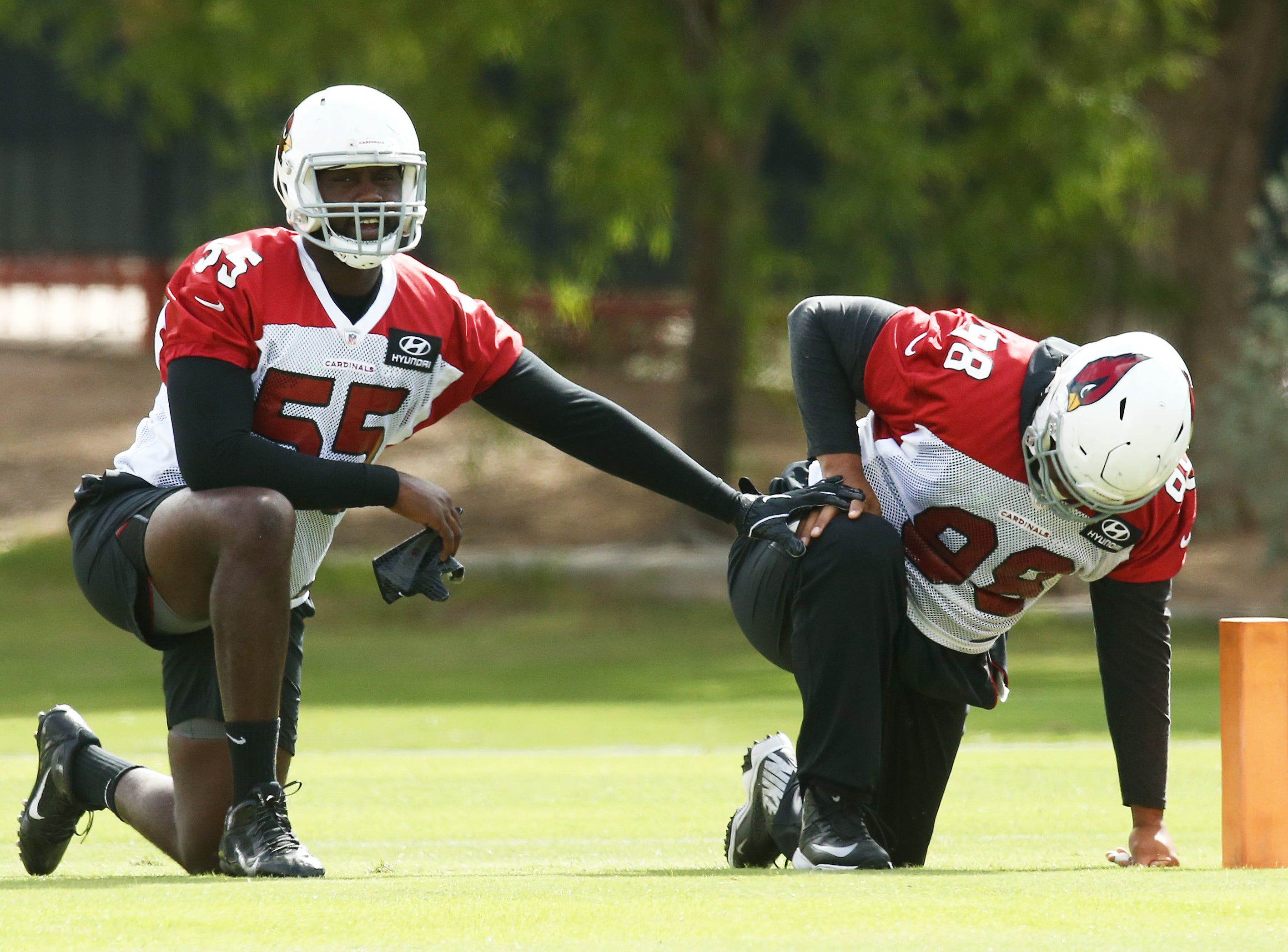 Arizona defensive end Chandler Jones (55) and defensive tackle Corey Peterts (98) during practice on Oct. 16, 2018 at the Cardinals Training Facility in Tempe, Ariz.