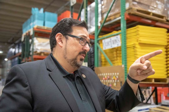 Maricopa County Recorder Adrian Fontes gives a tour of the election warehouse where workers are getting equipment ready for the November election.