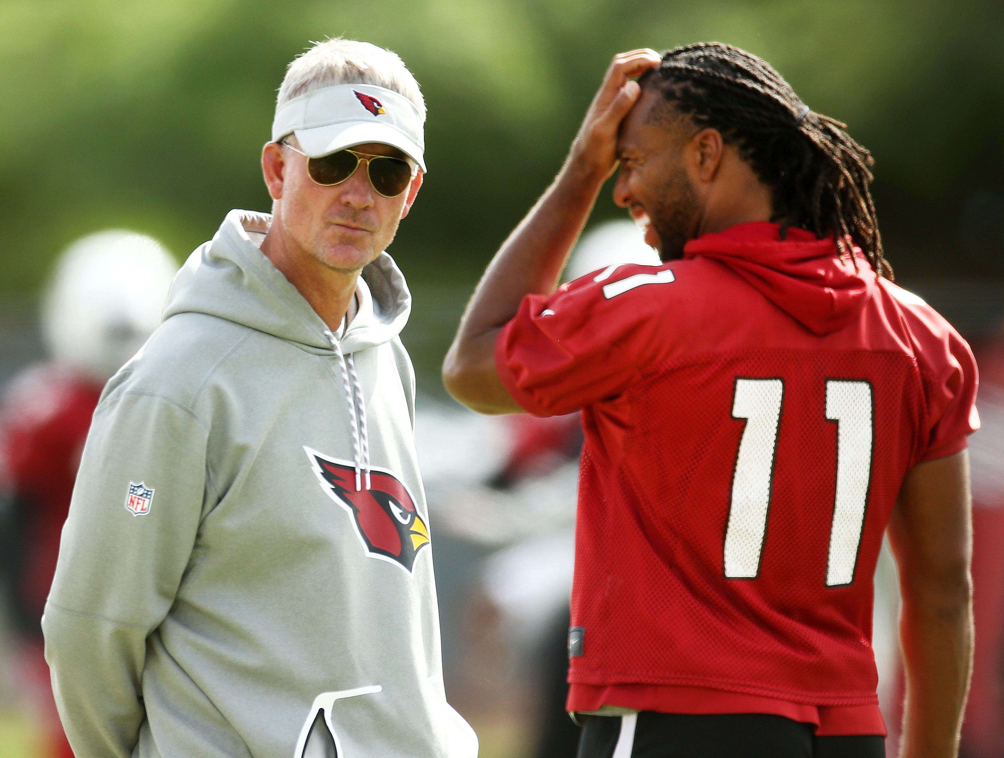 Arizona offensive coordintor Mike McCoy and Larry Fitzgerlad during practice on Oct. 16, 2018 at the Cardinals Training Facility in Tempe, Ariz.