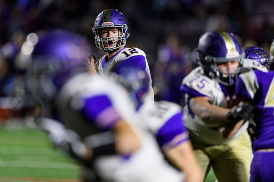Queen Creek quarterback Devin Larsen.