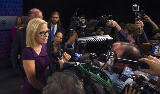 Rep. Kyrsten Sinema takes questions from the press after debating Rep. Martha McSally in the Arizona PBS studios at the Walter Cronkite School of Journalism and Mass Communication at Arizona State University in Phoenix, Monday, October 15, 2018. One of the two will become the first woman to represent Arizona in the United States Senate.