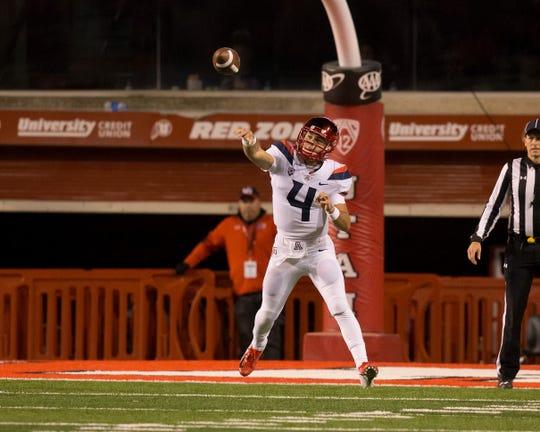Arizona Wildcats quarterback Rhett Rodriguez (4) passes the ball during the second half against the Utah Utes at Rice-Eccles Stadium.