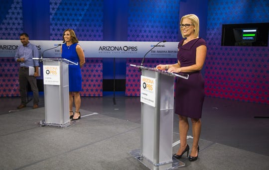 Rep. Martha McSally (left) and Rep. Kyrsten Sinema prepare to debate in the Arizona PBS studios at the Walter Cronkite School of Journalism and Mass Communication at Arizona State University in Phoenix on Oct. 15, 2018.