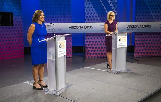 Rep. Martha McSally (left) and Rep. Kyrsten Sinema prepare to debate in the Arizona PBS studios at the Walter Cronkite School of Journalism and Mass Communication at Arizona State University in Phoenix on Oct. 15, 2018.