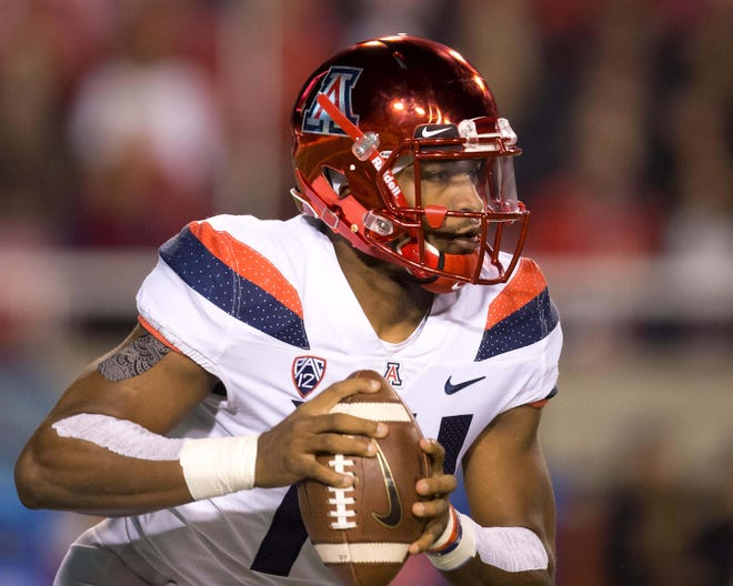 Arizona Wildcats quarterback Khalil Tate (14) looks downfield during the first quarter against the Utah Utes at Rice-Eccles Stadium.