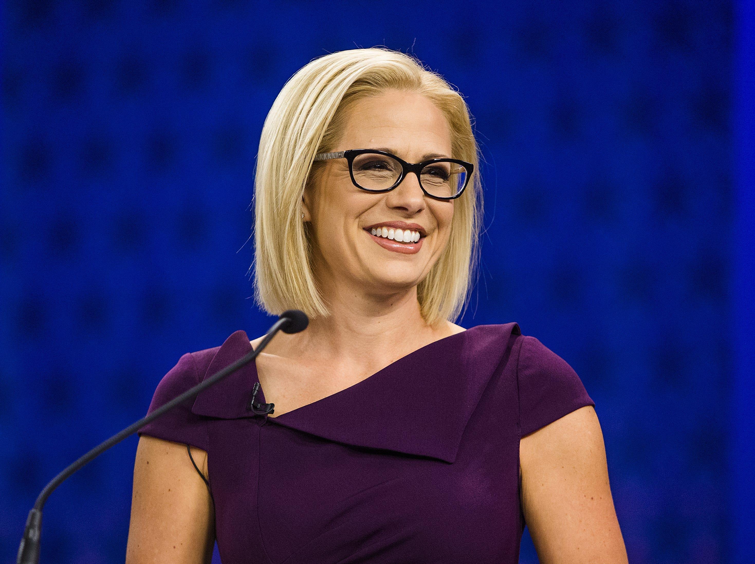 Rep. Kyrsten Sinema prepares to debate Rep. Martha McSally in the Arizona PBS studios at the Walter Cronkite School of Journalism and Mass Communication at Arizona State University in Phoenix on Oct. 15, 2018.