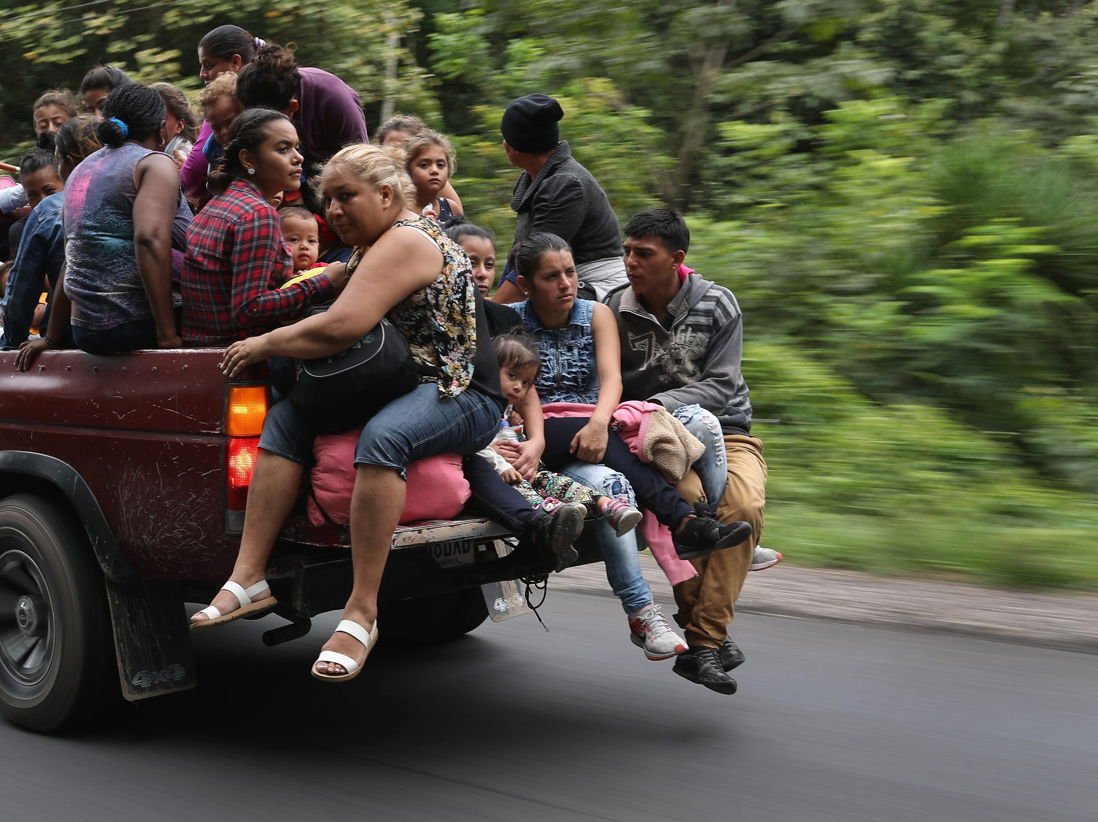 QUEZALTEPEQUE, GUATEMALA - OCTOBER 16:  Honduran immigrants, some of more than 1,500 people traveling in a migrant caravan, move north on October 16, 2018 near Quezaltepeque, Guatemala. A caravan of Central Americans, the second of its kind in 2018, began in San Pedro Sula, Honduras with plans to march north through Guatemala and Mexico in route to the United States. Honduras has some of the highest crime and poverty rates in Latin America. (Photo by John Moore/Getty Images)