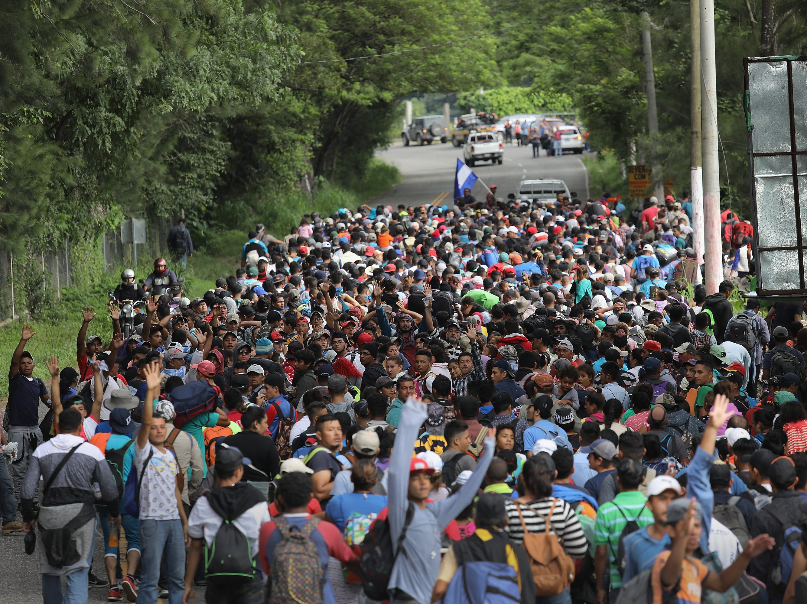 ESQUIPULAS, GUATEMALA - OCTOBER 16:  Some 1,500 Honduran immigrants walk north in a migrant caravan on October 16, 2018 near Esquipulas, Guatemala. The caravan, the second of its size in 2018, began last week in San Pedro Sula, Honduras with plans to march north through Guatemala and Mexico in route to the United States.  (Photo by John Moore/Getty Images)