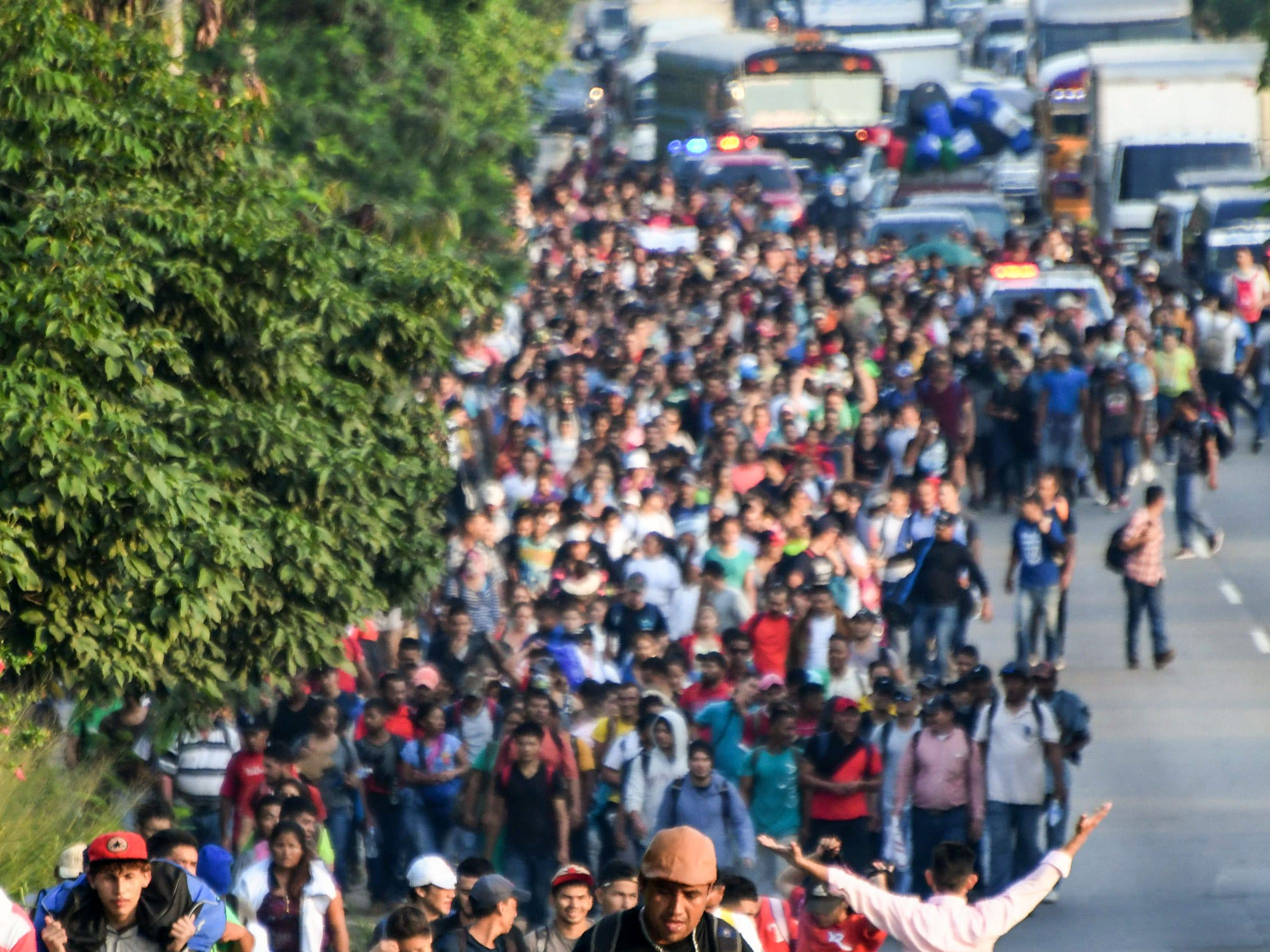 Hondurans walk towards the US from San Pedro Sula, 180 kms north from Tegucigalpa, on October 13, 2018. - Hondurans decided to left their country due to insecurity and the lack of employment opportunities. The exodus started from the bus station in San Pedro Sula towards the border with Guatemala. (Photo by ORLANDO SIERRA / AFP)        (Photo credit should read ORLANDO SIERRA/AFP/Getty Images)
