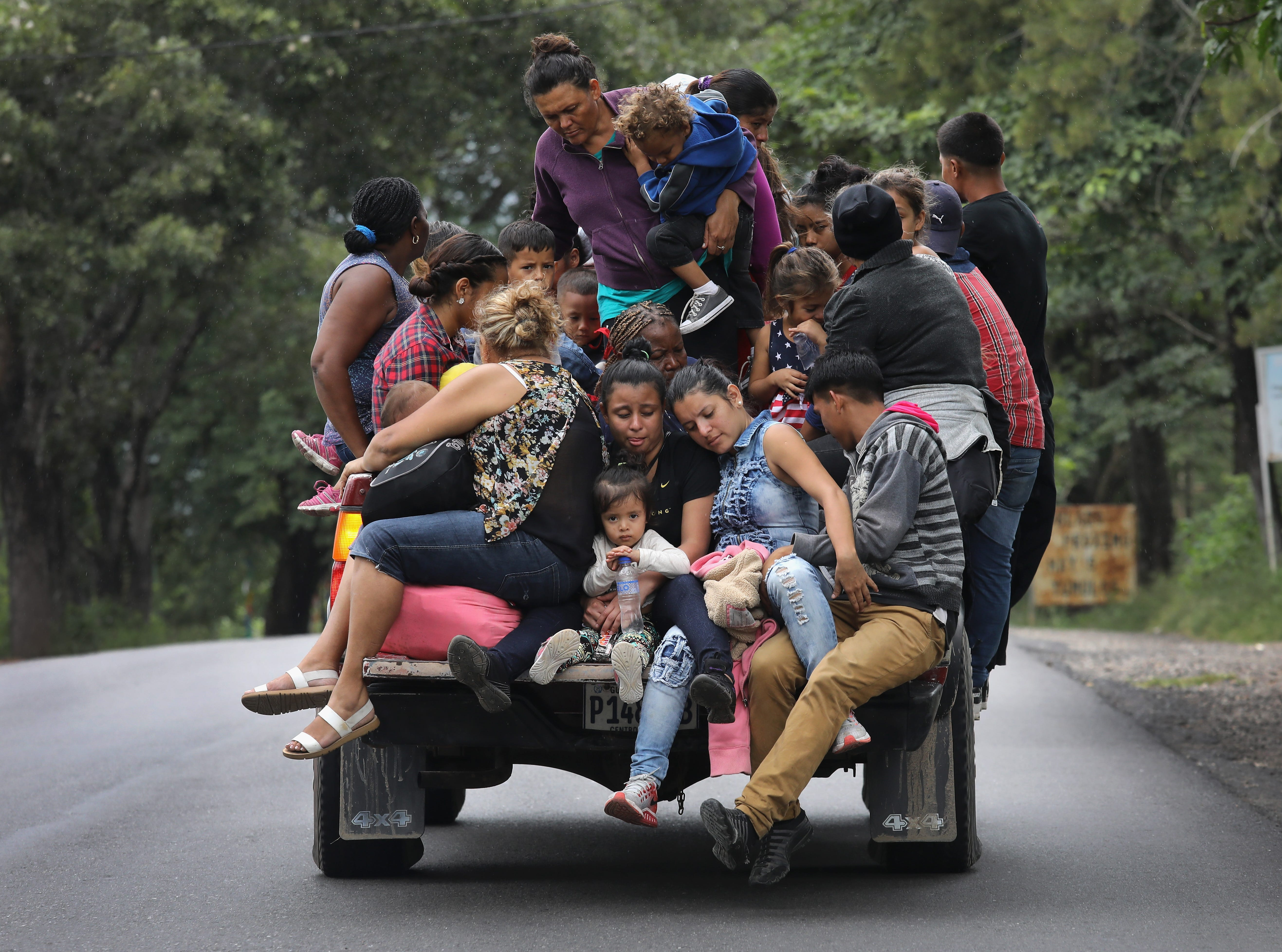 QUEZALTEPEQUE, GUATEMALA - OCTOBER 16:  Honduran immigrants, some of more than 1,500 people in a migrant caravan, travel north on October 16, 2018 near Quezaltepeque, Guatemala. The caravan, the second of its size in 2018, began last week in San Pedro Sula, Honduras with plans to march north through Guatemala and Mexico in route to the United States.  (Photo by John Moore/Getty Images)