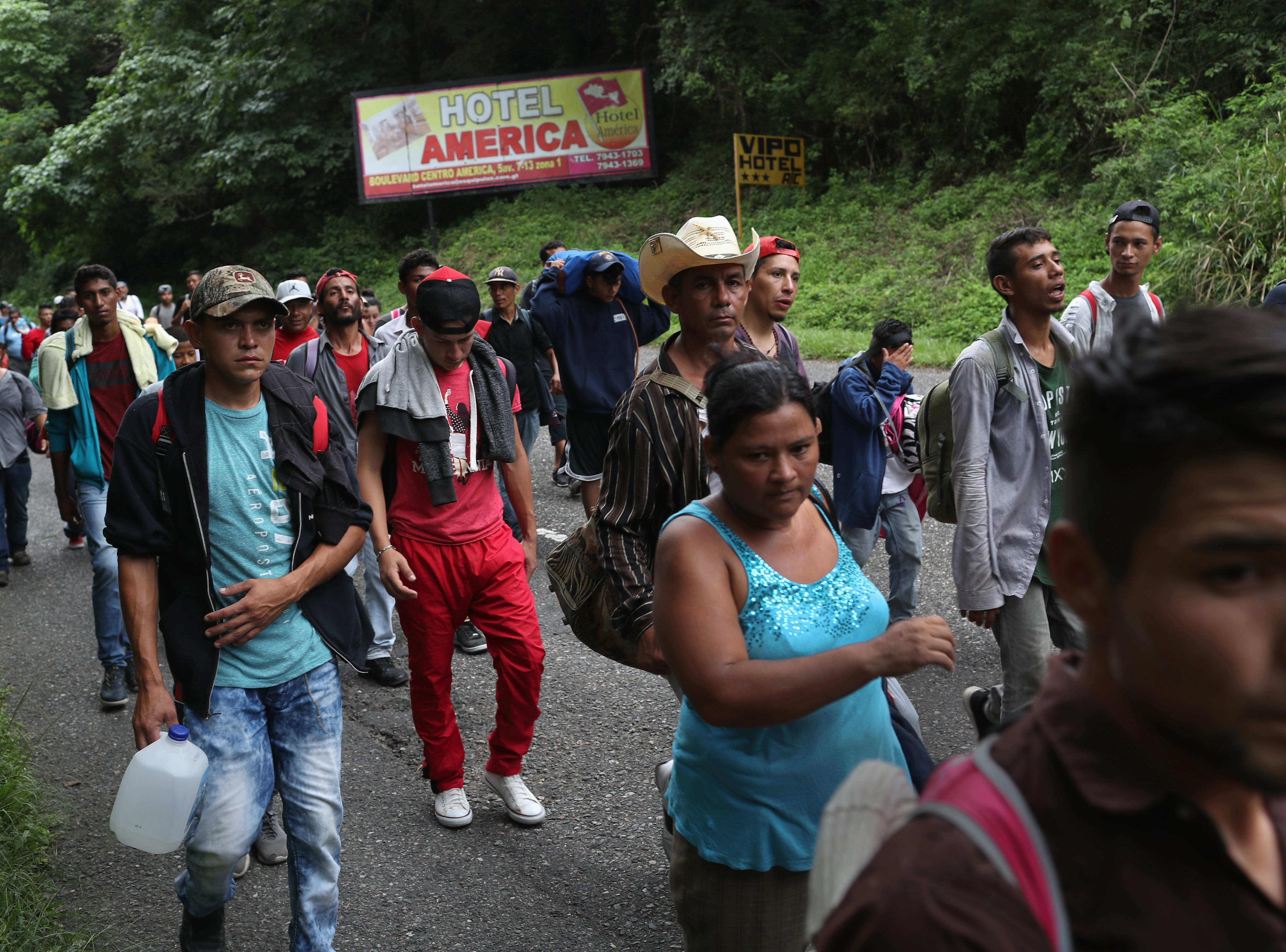 QUEZALTEPEQUE, GUATEMALA - OCTOBER 16:  Honduran immigrants, some of more than 1,500 people in a migrant caravan, travel north on October 16, 2018 near Quezaltepeque, Guatemala. A caravan of Central Americans, the second of its kind in 2018, began in San Pedro Sula, Honduras with plans to march north through Guatemala and Mexico in route to the United States. Honduras has some of the highest crime and poverty rates in Latin America. (Photo by John Moore/Getty Images)