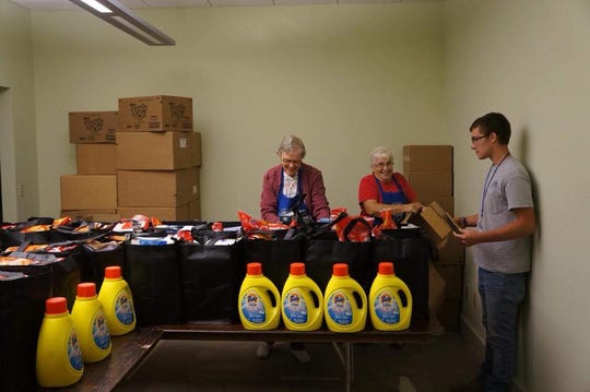 Attendees of Project Connect on Friday at the Sutton Center can receive a free tote bag full of food and a gallon of laundry detergent.