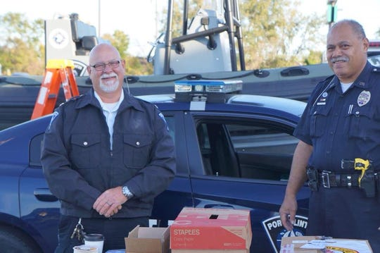 Port Clinton Police Chief Rob Hickman, left, and officer Ellis Fuiava participated in last year's Project Connect event.