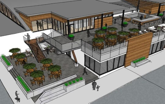 The two-story option of the proposed downtown marketplace at 318 Grand River Ave. includes a roof-top area for a bar or restaurant. The cost difference between this option and just a main-floor venue is $3.2 and $2.7 million.