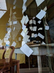 Writer Maureen Cummins has been writing in the window of Pig Bar & Grill on Partition Street during Shout Out Saugerties.