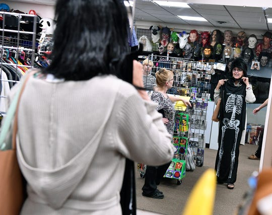 Linda Youkum of Shrewsbury, tries on different wigs for her Halloween costume at Make Believin' in Spry, Tuesday, October 16, 2018. John A. Pavoncello photo
