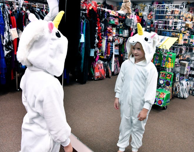 Kathryn Smith, 6 of Seven Valleys, checks out her unicorn costume for Halloween at Make Believin' in Spry, Tuesday, October 16, 2018. John A. Pavoncello photo