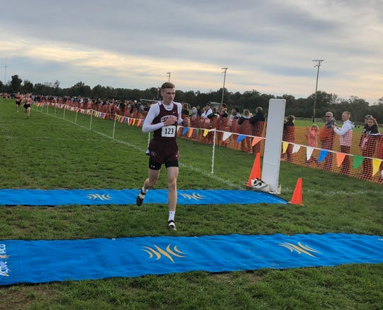 Gettysburg's Andrew Hirneisen crosses the finish line first at the York-Adams League Boys' Cross Country Championship Run at Gettysburg.