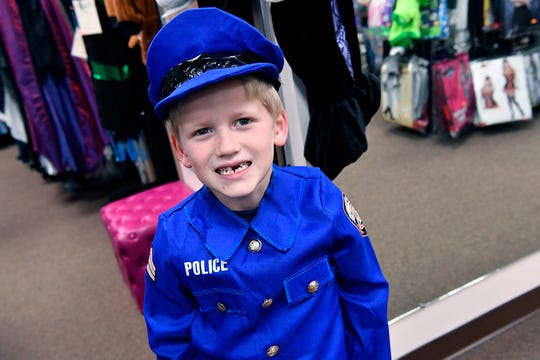 Joseph Smith, 6 of Seven Valleys, shows off his police costume for Halloween at Make Believin' in Spry, Tuesday, October 16, 2018. 