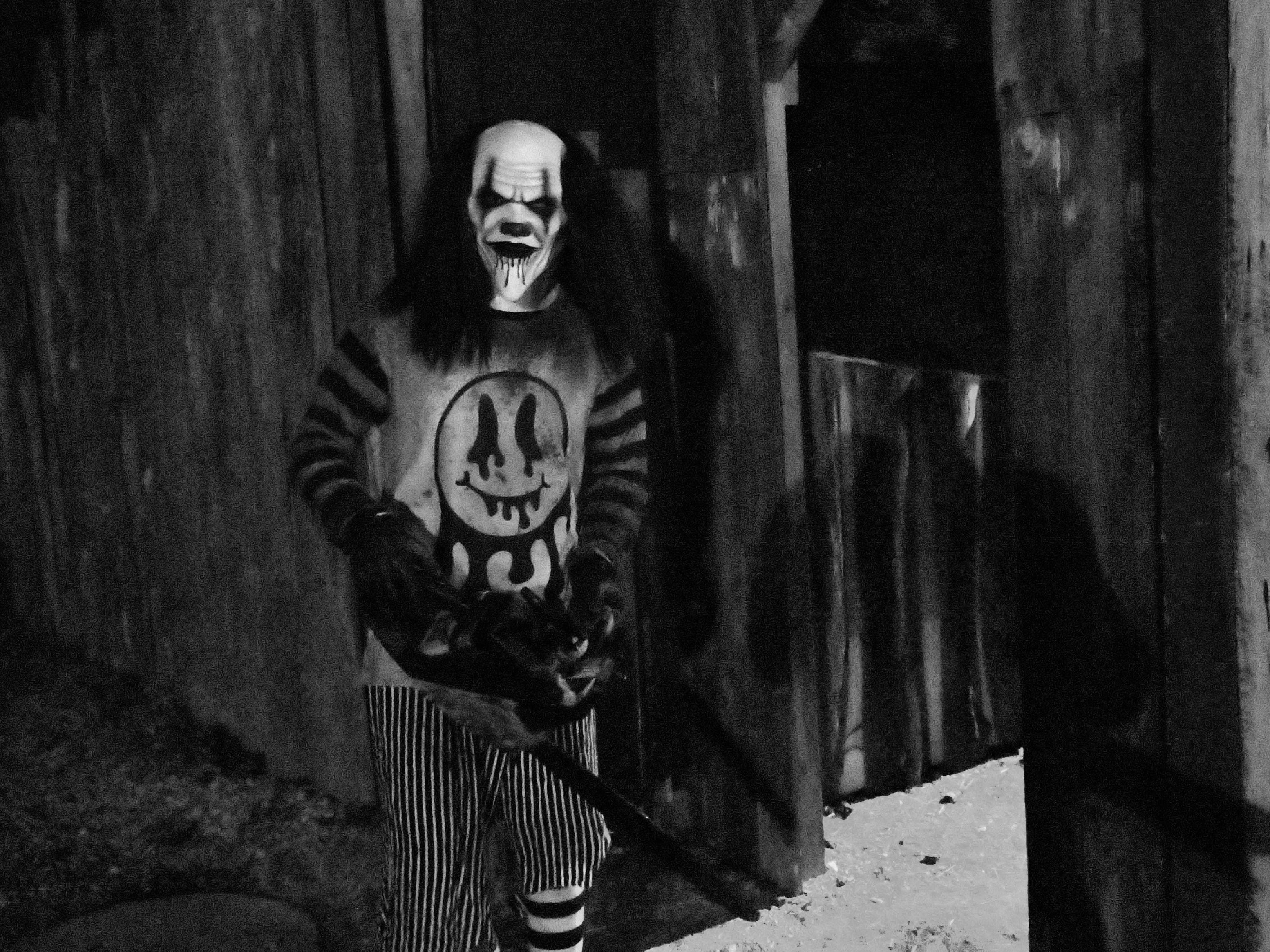 A menacing clown waits for unsuspecting people who escape the maze at Kim's Krypt Haunted Mill, October 12, 2018.