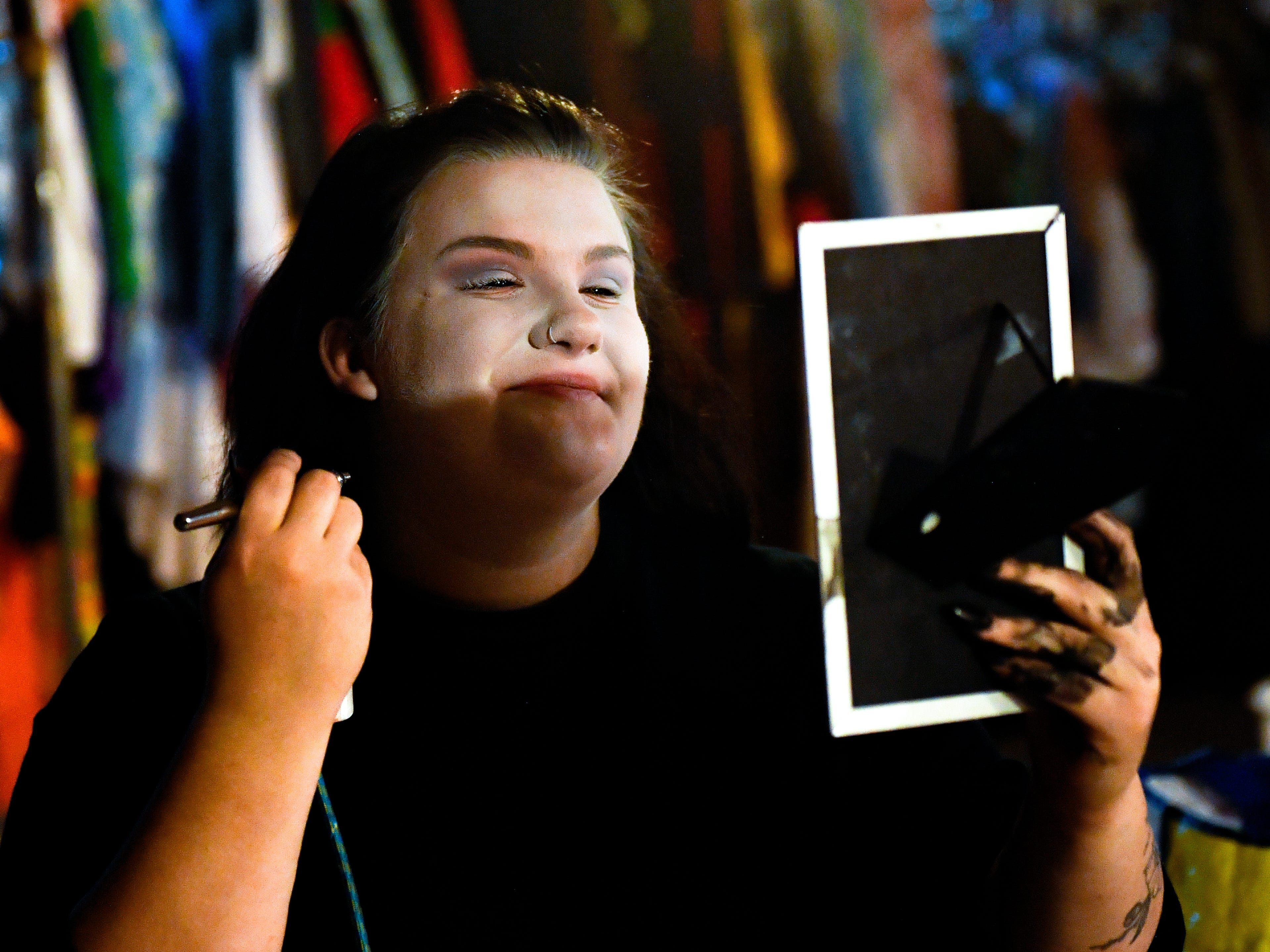 Actors apply face paint to transform them into ghoulish creatures at Kim's Krypt Haunted Mill, October 12, 2018.