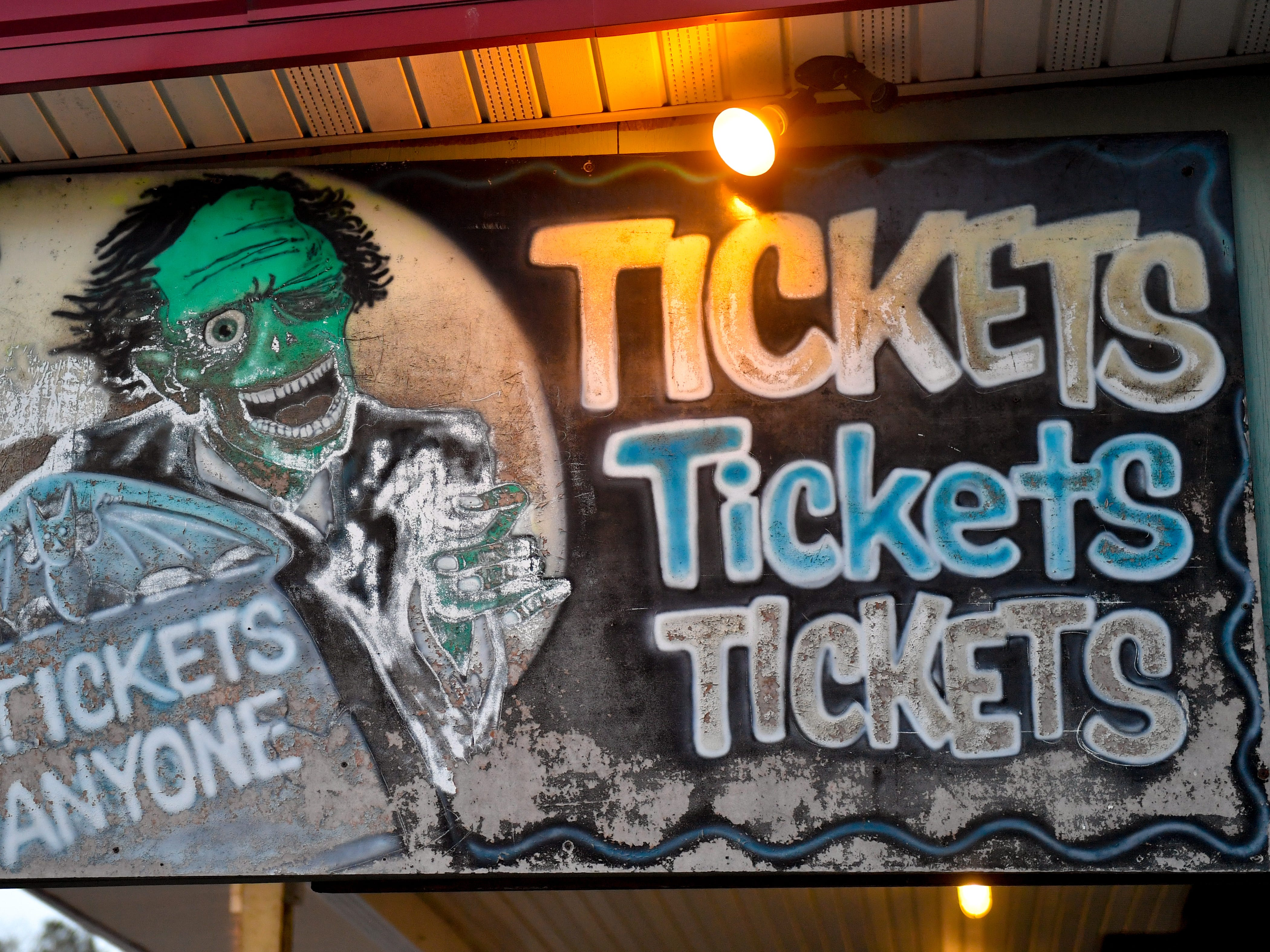 Hand made signs hang all over Kim's Krypt Haunted Mill, October 12, 2018.