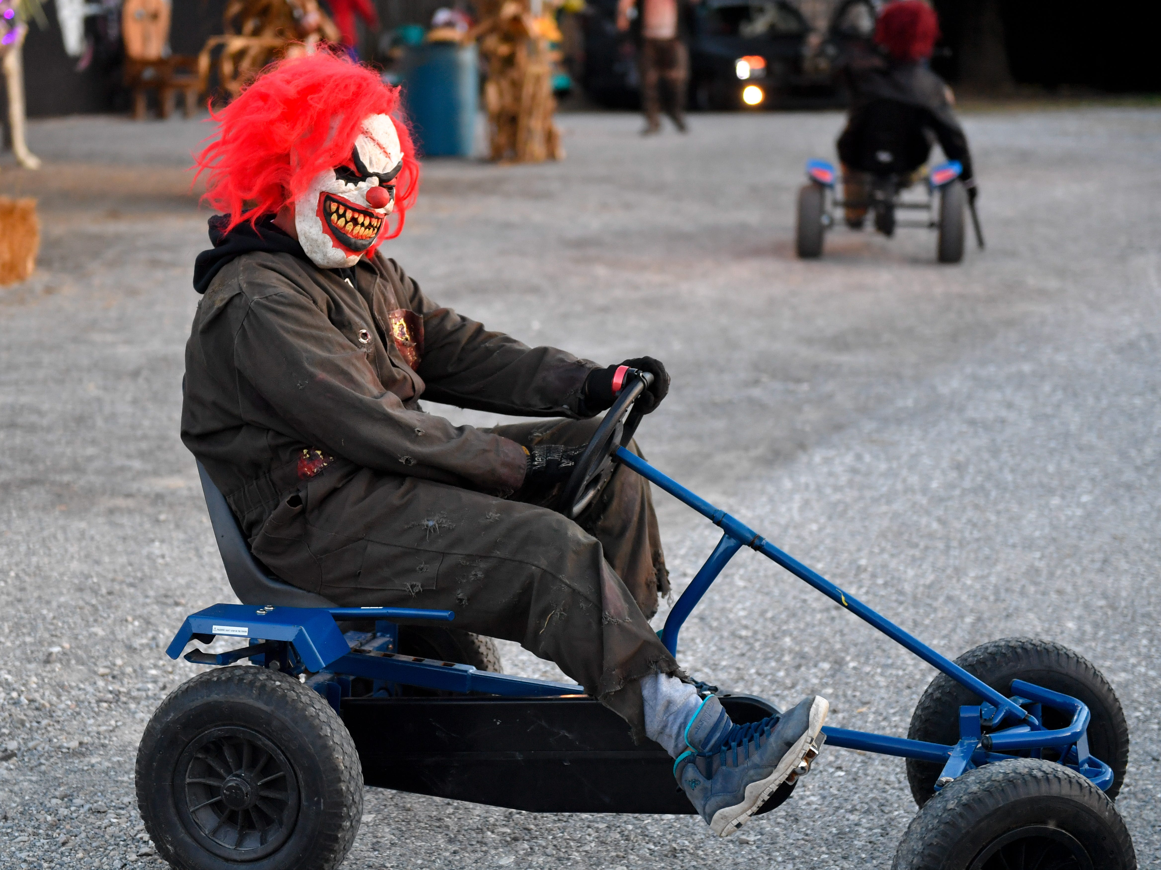 Actors ride around on tricycles creeping out anyone that sees them at Kim's Krypt Haunted Mill, October 12, 2018.