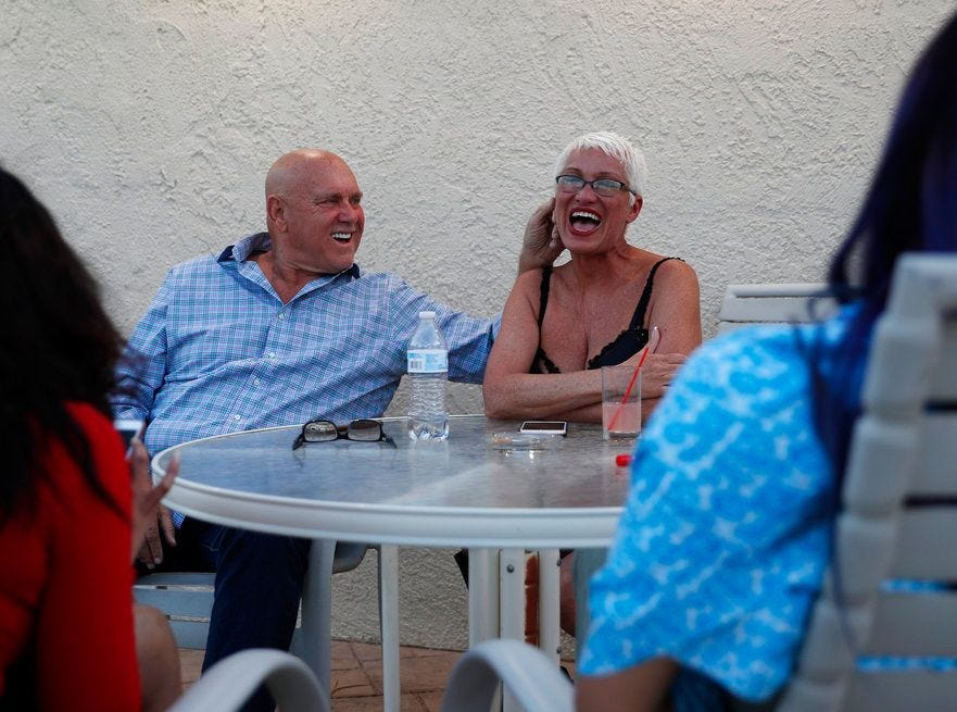 Brothel owner Dennis Hof, left, jokes with madam Sonja Bandolik at the Love Ranch brothel in Crystal on April 27.   AP file In this April 27, 2018, photo, owner Dennis Hof, left, jokes with madam Sonja Bandolik at the Love Ranch brothel in Crystal, Nev. A coalition of religious groups and anti-sex trafficking activists have launched referendums to ban brothels in two of Nevada's seven counties where they legally operate. Hof, a legal pimp challenging an incumbent Republican lawmaker Tuesday, June 12, says a push to ban legal brothels is political retribution. (AP Photo/John Locher)