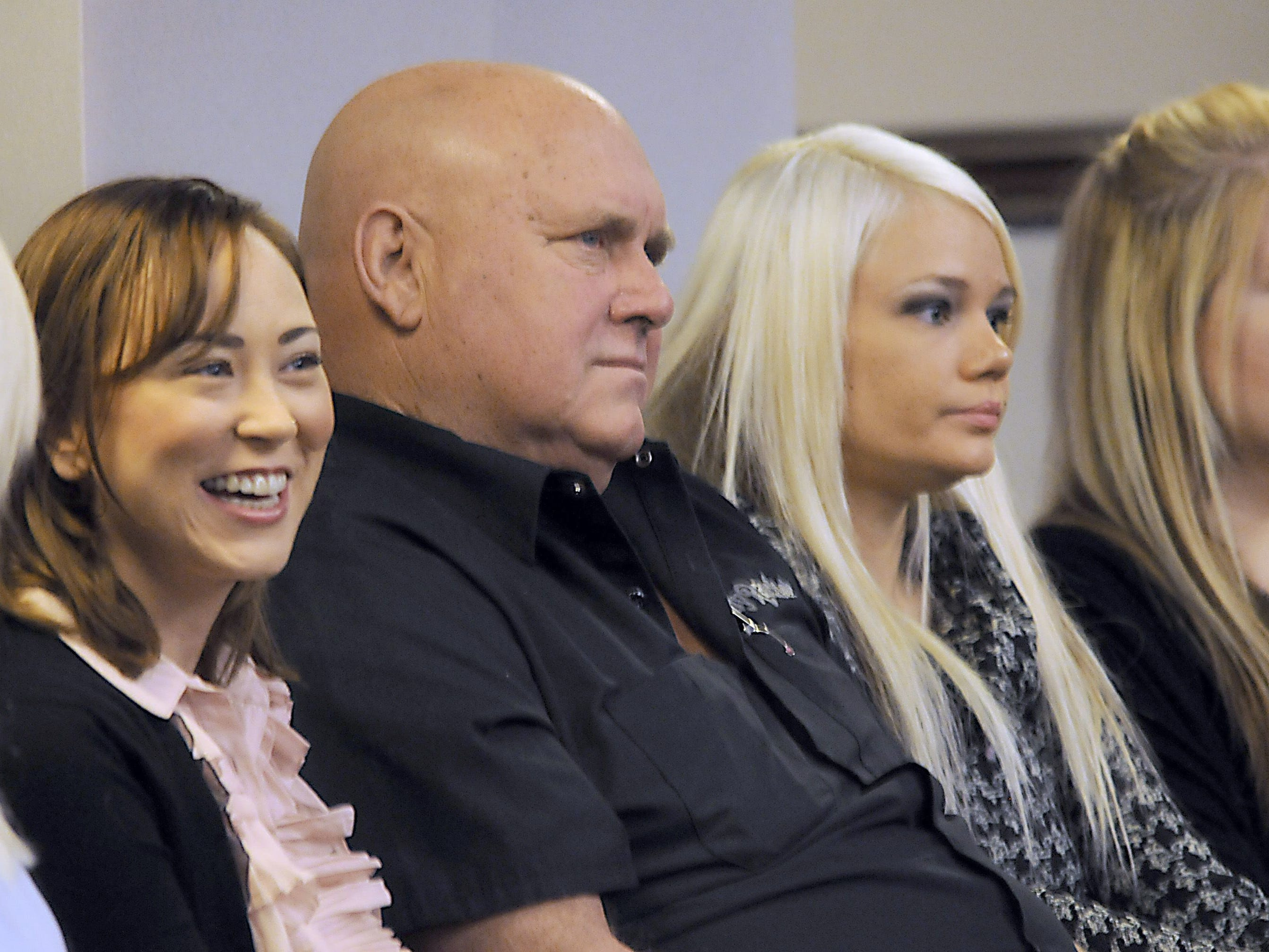 Dennis Hof, owner of the Moonlite Bunny Ranch and other brothels sits in the Assembly chambers of the Nevada Legislature in 2011, along with some of the women who worked there, to listen to Harry Reid tell the Legislature that prostitution should be outlawed.  Marilyn Newton / RGJ file Dennis Hof, owner of the Moonlite Bunny Ranch and other brothels sits in the Assembly chambers of the Nevada Legislature Tuesday Feb. 22, 2011, along with some of his girls, to listen to Harry Reid tell the Legislature that prostitution should be outlawed.