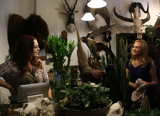 Owner Emily Felch, left, interacts with a customer at her Natural Selection store in Reno on Oct. 12, 2018.