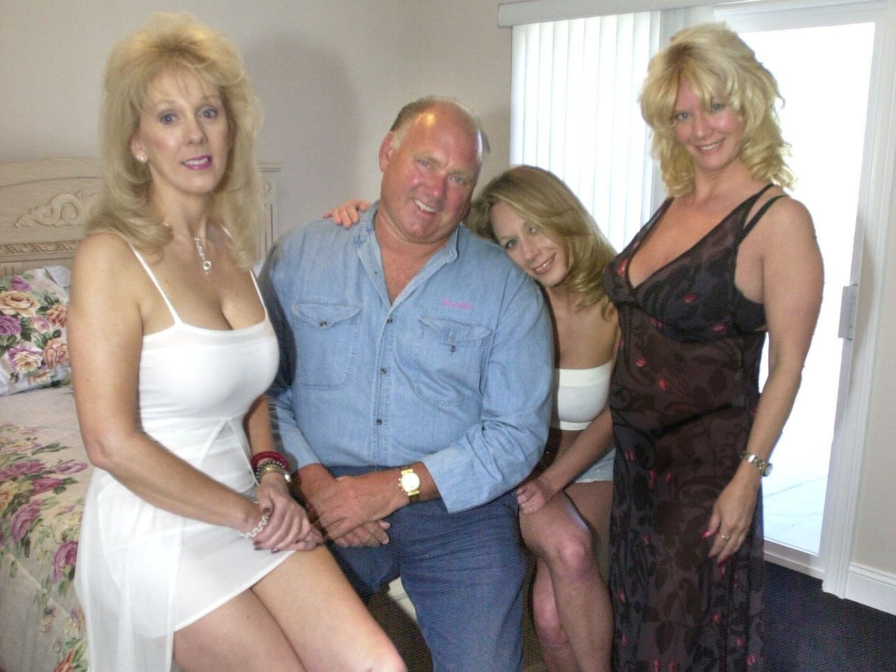 Photo by Lisa J. Tolda...Dennis Hof poses with some of his girls at the Moonlite ((Do not change. It is now Moonlite; look at Dennis' shirt.) Bunnyranch in Mound House.**digital**