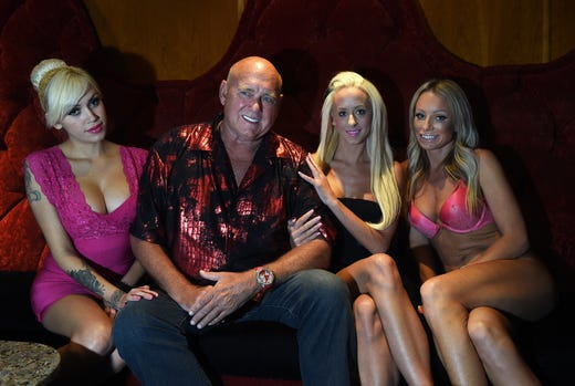 Brothel Owner And Nevada Businessman Dennis Hof Poses For A Portrait With From Left