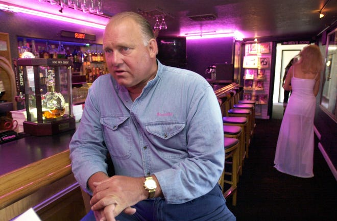 Dennis Hof sits at the bar of his Moonlite Bunnyranch in Mound House.